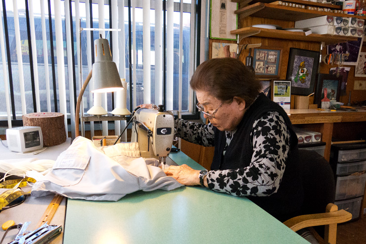 Sato Hughes at her trusty sewing machine.